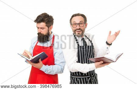Household Duties. Cooking Food Recipes. How To Cook. Men Bearded Hipster Cook Apron Reading Books Ab