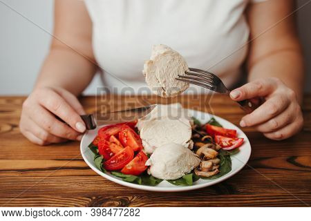 Diet Concept, Healthy Lifestyle, Low Calorie Food, Low Carb Diet. Fat Woman Eating Baked Chicken Bre