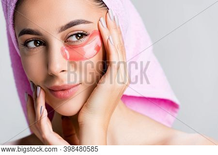 Beautiful Woman With Towel On Hair And Hydrogel Eye Patch On Face Isolated On Grey