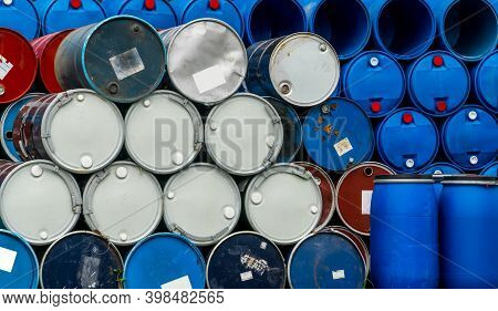Old Chemical Barrels. Blue And Red Oil Drum. Steel And Plastic Oil Tank. Toxic Waste Warehouse. Haza