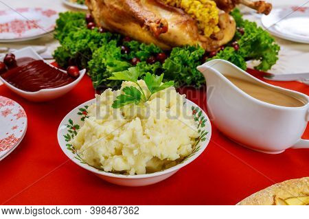 Mashed Potatoes, Gravy And Turkey For Christmas Or Thanksgiving Dinner Table.