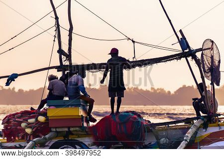A Team Of Fishermen On A Boat Prepares To Fish At Sunset. Sri Lanka, Weligama, 2017-12-08
