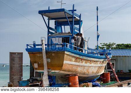 Mechanics Repairing An Old Fishing Boat On The Shore. Sri Lanka, Weligama, 2017-12-28