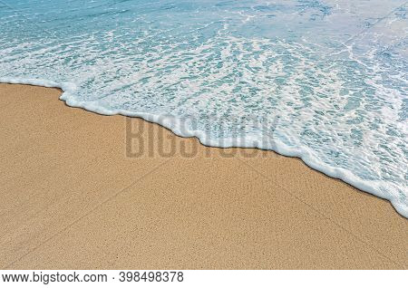 Soft Wave Of Blue Ocean On Sandy Beach. Empty Place For Text, Copy Space.  Photo With Soft Focus.