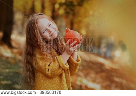 Irish Little Girl Outdoor Photo With Pumpkin On Fall Landscape Background