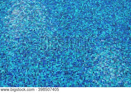 Abstract Image Of Soft Focus Blue Water With Ceramic Tile Mosaic In Swimming Pool From Top View.