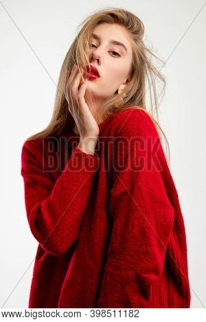 Casual Glamour. Modern Trend Look. Fashion Model. Beautiful Sensual Woman In Red Oversize Sweater To