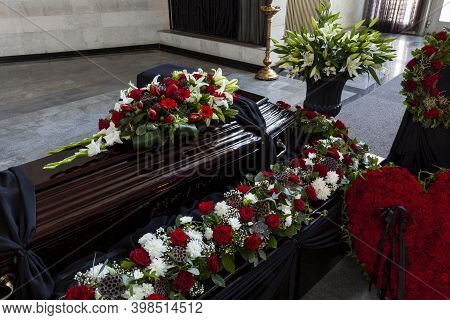 A Coffin Decorated With Flowers. Beautiful Farewell Ceremony.