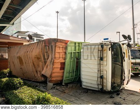 A Truck Carrying A Container Overturned On A Road Under A Bridge Over An Intersection. No Focus, Spe