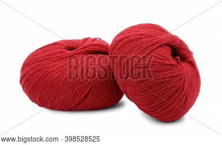 Two Hanks Of Red Yarns Isolated On White Background.