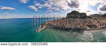 Sunset At The Beach Of Cefalu Sicily, Old Town Of Cefalu Sicilia Panoramic View At The Colorful Vill