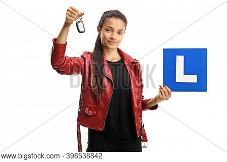 Female driver holding a car key and a learner plate isolated on white background