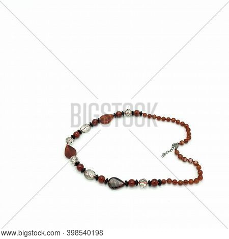 Women\'s Bijouterie. Necklace Made Of Terracotta, Black And Transparent Beads Of Various Shapes. Met