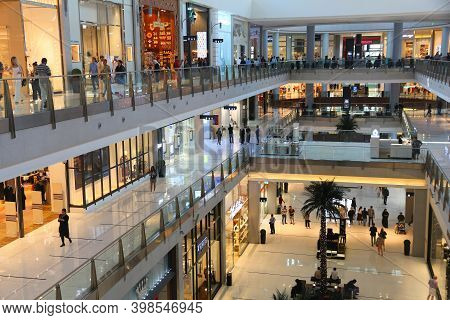 Dubai, Uae - November 22, 2017: Shoppers Visit Dubai Mall. It Is The Largest Mall In The World By To