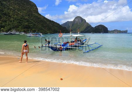 Palawan, Philippines - December 2, 2017: People Visit The Beach Of Tourist Resort Town Of El Nido In
