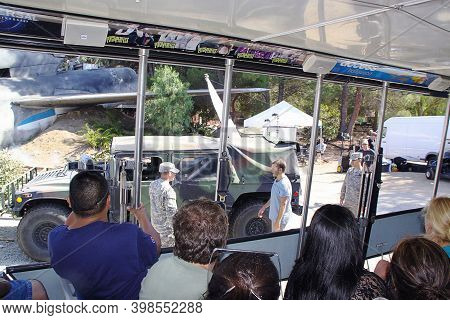 Group Of People On Studio Tour Called Backlot Tour. Ride Attraction At The Universal Studios Hollywo