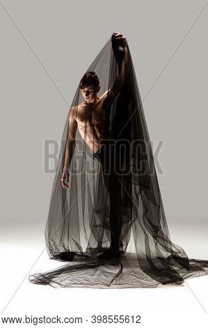 Elegance. Graceful Classic Ballet Male Dancer Isolated On White Studio Background. Man In Minimalist