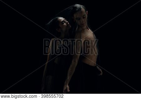 Touch. Graceful Classic Ballet Dancers Isolated On Black Studio Background. Couple In Minimalistic D