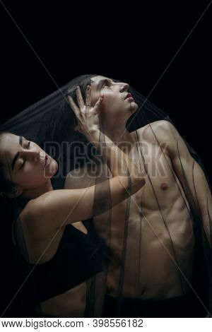 Together. Graceful Classic Ballet Dancers Isolated On Black Studio Background. Couple In Minimalisti