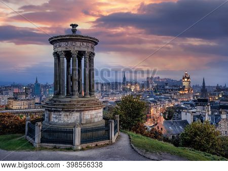 Panorama Of Edinburgh Against Sunset With Calton Hill And Edinburgh Castle In Scotland, United Kingd