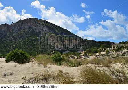 Dune Of Gialova In Beautiful Lagoon Of Voidokilia And Palaiokastro Castle Of Ancient Pylos. On Backg