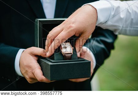 Cropped Shot Of A Man Wearing Elegant Suit And Hold Wrist Watch. Man Hand With Elegant Expensive Lux