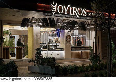 Thessaloniki, Greece - December 6 2020: Hellenic Empty Gyros Shop Without Crowd. Illuminated Night V