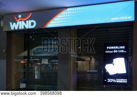 Thessaloniki, Greece - December 6 2020: Wind Telecommunications Store Facade With Logo. Illuminated