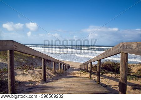 Beach Wooden Boardwalk Leading Down To The Atlantic Ocean. Landscape Photography At Quiaios Beach In