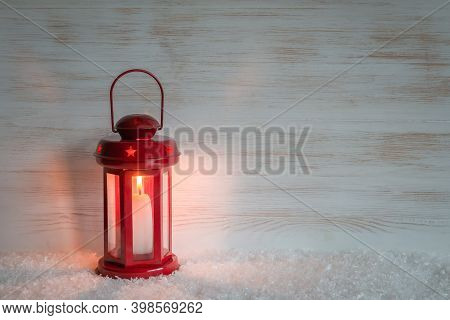 Vintage Christmas Lantern On Wooden Wall With Copy Space. Red Lantern With Candlelight On Wood Backg