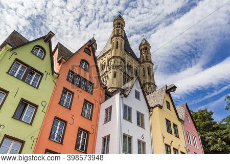 Colorful Old Houses And Church Tower At The Fish Market Square In Koln, Germany