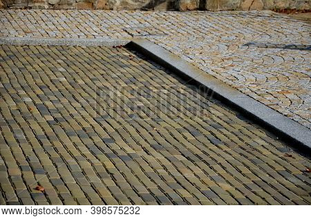 Fired Bricks As Tiles, Made Of Gray To Yellow Clay. This Is Old Type Of Paving Similar To Interlocki