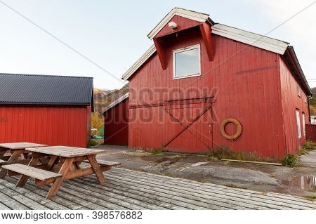 Norwegian Fishing Village. Red Wooden Fishing Barns Stand On The Sea Coast. Vingvagen, Norway