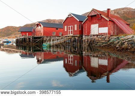 Traditional Old Norwegian Red Wooden Barns Stand On The Sea Coast. Snillfjord, Sor-trondelag Region,
