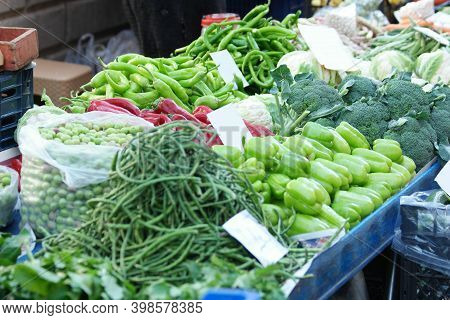 Market Stall With Fresh Vegetables. Variety Of Colorful Vegetables At Farm Market Stall. Organic Foo
