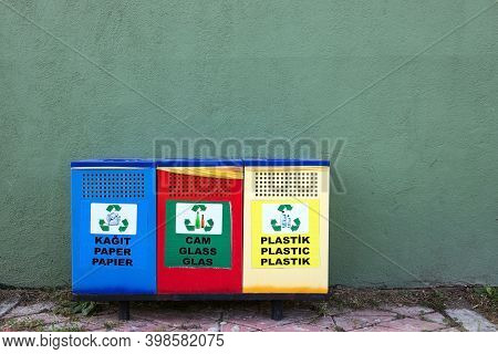 Three Different Garbage Cans For Recycling Garbage On A Street In Turkey. Separate Buckets For Plast