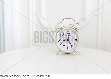 Focus Alarm Clock Vintage Style With Blurry White Background In The Bedroom. Wake Up Maker, Wake Up