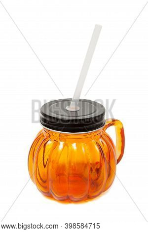 Orange Mug With A Black Cover, Handle And Straw Isolated On White Background.
