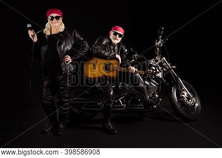 Photo Of Two People Old Bikers Man Lady Duet Chopper Rock Festival Play Guitar Sing Song Youth Years