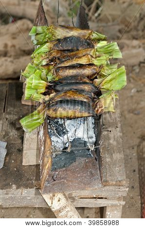 Khmer snack with sticky rice wrapped in banana leaves