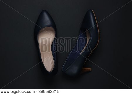 Women's Classic High-heeled Shoes On A Black Background. Top View