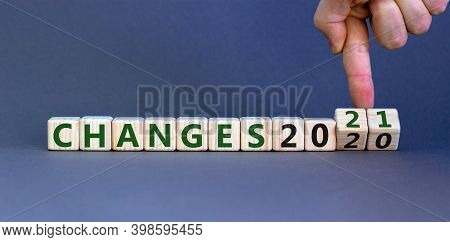 2021 New Year Changes. Male Hand Flips Wooden Cube And Changes The Inscription 'changes 2020' To 'ch