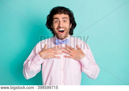 Photo Portrait Of Guy Touching Chest With Two Hands Getting Chosen Isolated On Pastel Teal Colored B