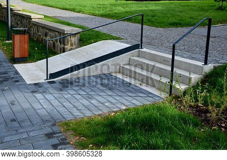 Name Gray Monolithic Concrete Park Bench Made Of Concrete In The Shape Of Round Stones Wooden Stairc
