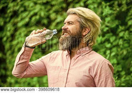 Refreshing Lemonade. Soda Water. Water Balance. Man Bearded Tourist Drinking Water Plastic Bottle Na