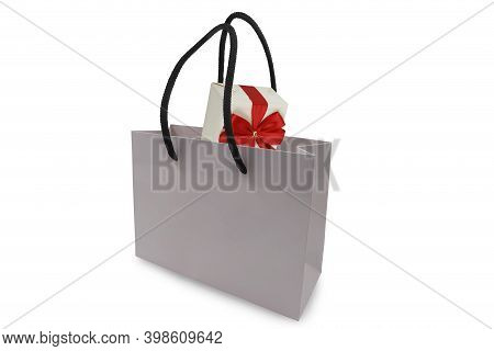 Gift In Shopping Bag Isolated On White Background
