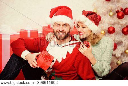 Couple In Love Enjoy Christmas Holiday Celebration. Loving Couple Cuddle Smiling While Unpacking Gif