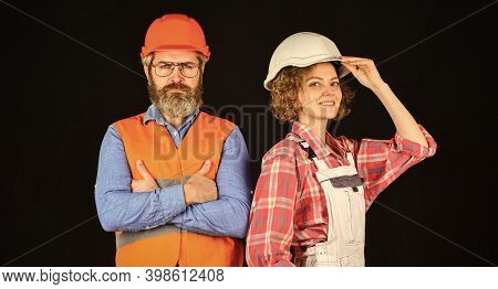Couple At The Construction Site. Couple Making Repairs To Their Home. Home Renovation. Couple Is Ren