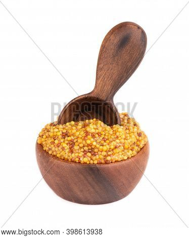 Grain Mustard Sauce In Wooden Bowl, Isolated On White Background. Mustard Beans.