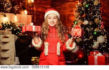 Happy New Year. Xmas Gift For Little Girl. New Year Holiday. Little Girl In Hat. Xmas Holiday. Santa